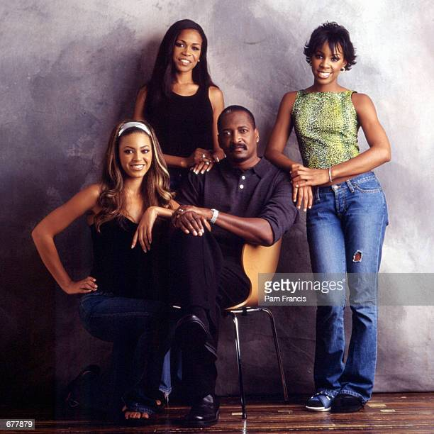 Destiny's Child and Matthew Knowles pose for a portrait October 30 2000 in Houston TX
