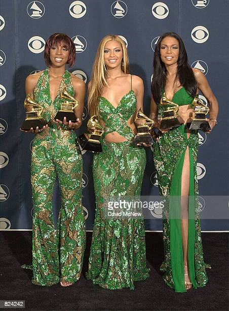 Destiny's Child poses backstage with their awards at the 43rd annual Grammy Awards February 21 2001 at Staples Center in Los Angeles CA The group won...