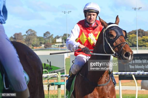 Destiny's Revenge ridden by Mark Pegus returns to the mounting yard after winning the The Bottle O 3YO Maiden Plate at Swan Hill Racecourse on July...