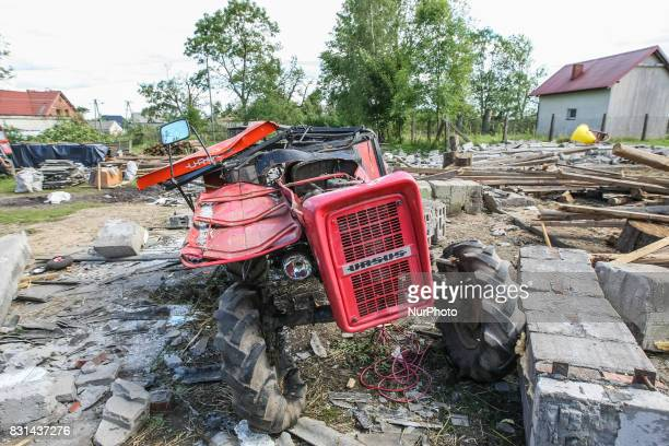 Destroyed building and smashed tractor is seen in the Sylczno village northern Poland on 14 August 2017 Storms which on Friday 11th August night and...