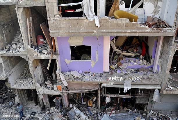 A destroyed building is seen at the site of a car bomb explosion in the alZahraa neighborhood in Homs on October 29 2014 At least 37 people including...