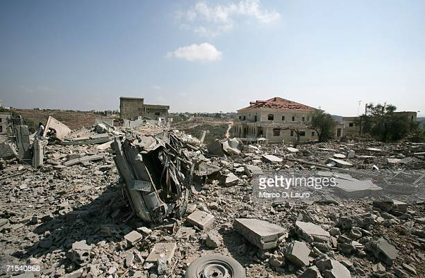 Destroyed buildings are seen after an Israeli air strike July 30 2006 in Qana Southern Lebanon Approximately 56 civilians were killed at least 34 of...