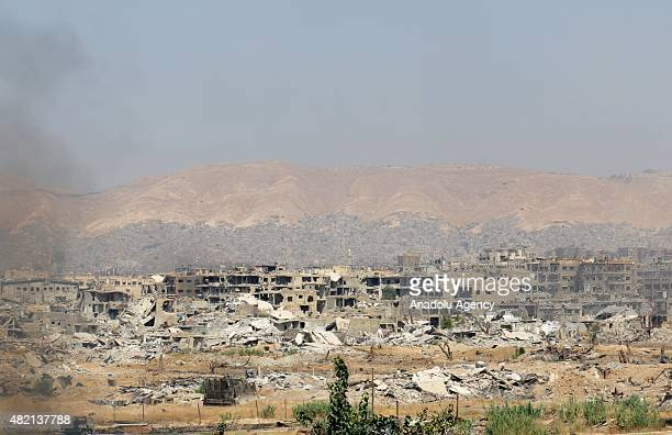 Destroyed buildings are seen after Assad forces attack to Jobar district of Damascus on July 27 2015