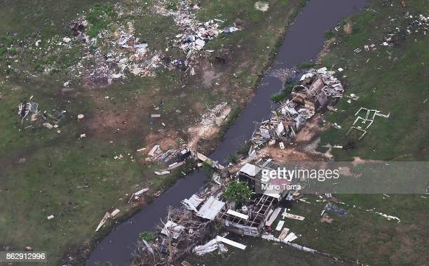 Destroyed buildings are viewed from the air during recovery efforts four weeks after Hurricane Maria struck on October 18 2017 inflight over Puerto...
