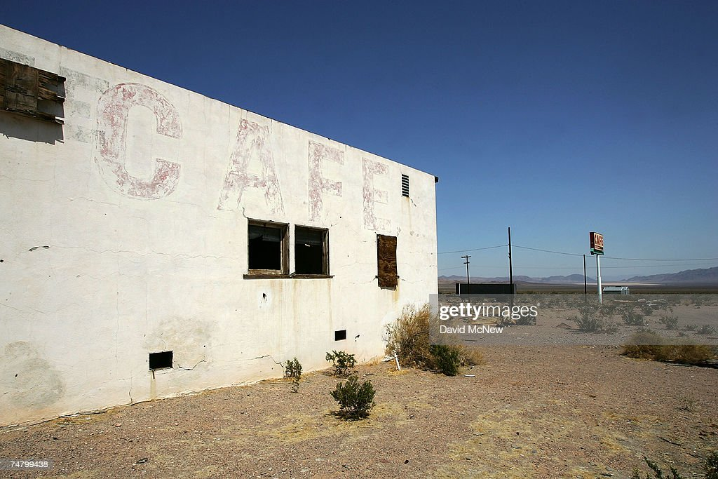 A destroyed cafe stands along old Route 66 on June 16, 2007 in Ludlow, California. Route 66 opened in 1926 to become an icon of American motoring freedom. It stretched from Chicago to Los Angeles and became a western migration route for people looking for work during the great depression of the 1930s or to escape the Dust Bowl disaster. Later it offered vacation getaways and driving adventures until 1985 when it was decommissioned as a federal highway. Today the motels, gas stations, and roadside attractions along the 'Mother Road' are disappearing at an alarming rate. Route 66 aficionados try to preserve some reminders of the by-gone era ? restoring some buildings, collecting memorabilia, and erecting thousands of new signs that read 'Route 66' - but most of the old landmarks are already in a state of decay or destroyed by vandals and neglect. Freeways, modern hotel chains, developer's projects, and even tourist attractions are blotting out the original reminders of the highway that inspired countless movies, books, and songs about life on the Western highway. Last week the National Trust for Historic Preservation included the old motels of Route 66 on its list of the 11 most endangered historic places.