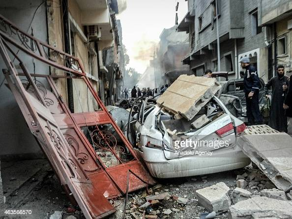 Destroyed car by debris of a building seen after Egypt's army warplanes carried out airstrikes in neighboring Libya against targets belonging to the...