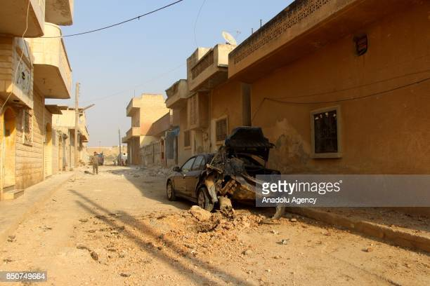 A destroyed car is seen at the site after airstrikes hit Khan Sheikhun town of Idlib Syria on September 21 2017