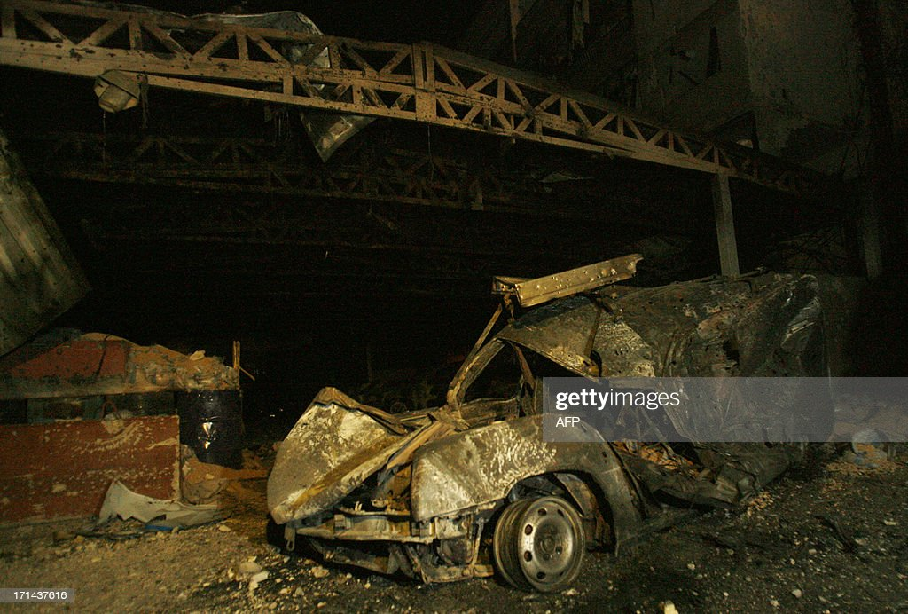 A destroyed car is seen outside the Bilal bin Rabah mosque following clashes between the Lebanese army and supporters of radical Sunni cleric Sheikh Ahmad al-Assir in the Abra district of the southern city of Sidon on June 24, 2013. Lebanon's army made significant advances on a complex of buildings, including the mosque, used by supporters of Assir in the south, after 16 soldiers died in two days of fighting, military sources said. AFP PHOTO/MAHMOUD ZAYYAT