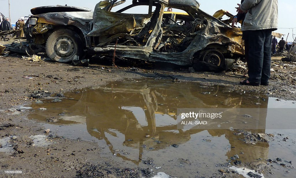 A destroyed car lies at the scene of an explosion at the bird market in the north Baghdad Shiite neighbourhood of Kadhimiyah on February 8, 2013. A spate of car bombs in Shiite areas of Iraq, including two blasts minutes apart at a popular bird market, killed at least 29 people, the latest in a spike in violence amid a political crisis. The attacks, which left nearly 70 others wounded, primarily targeted marketplaces that are often crowded on Fridays, the weekly holiday in Iraq, and took the death toll from a week of violence to more than 100. AFP PHOTO/ ALI AL-SAADI