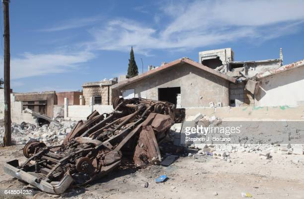A'ZAZ ALEPPO SYRIA Destroyed cars and homes after a MIG bombing raid in A'zaz Syria