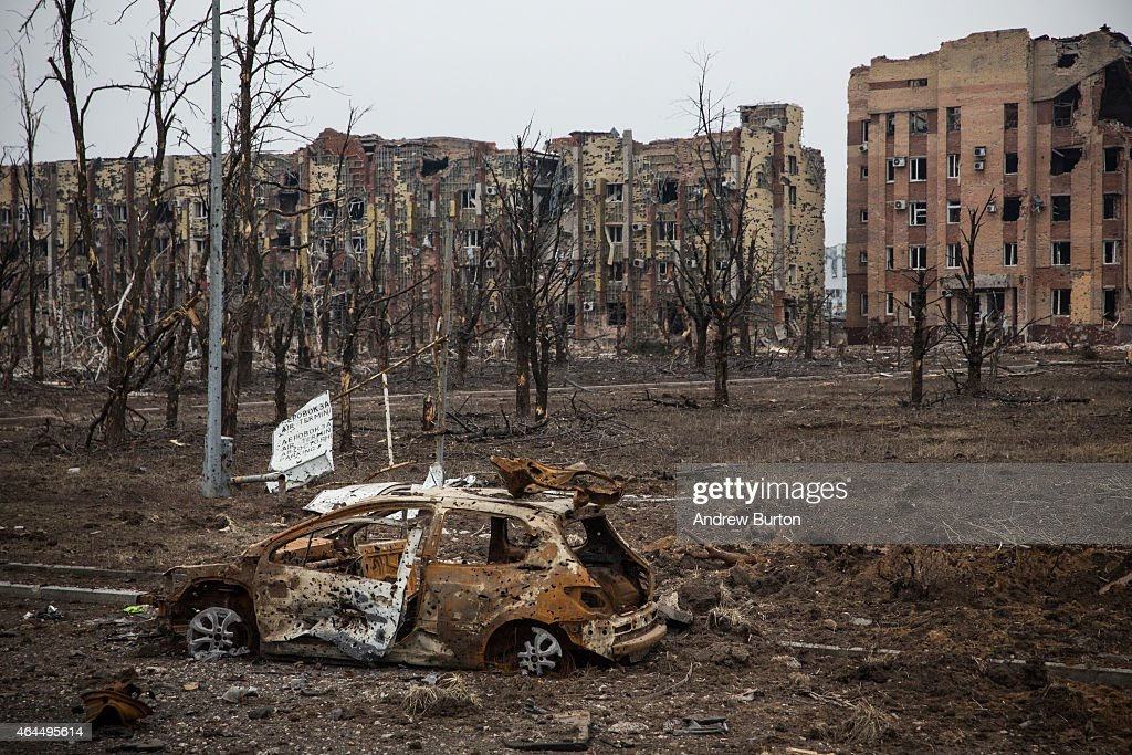 Destroyed cars are seen near the Donetsk airport on February 26 2015 in Donetsk Ukraine The Donetsk airport has been one of the most heavily fought...