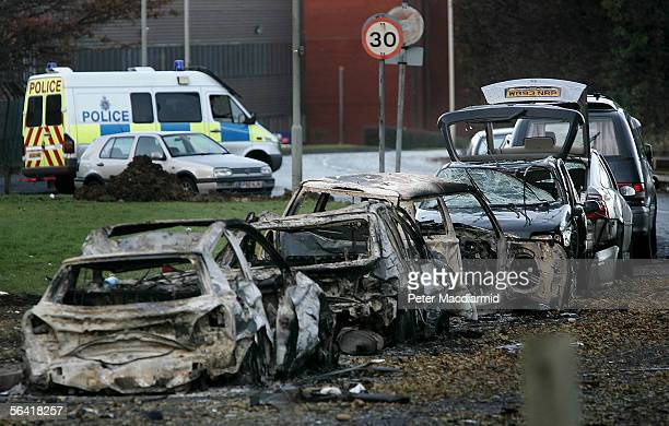 Destroyed cars line the road at the Buncefield oil depot on December 12 2005 in Hemel Hempstead England Fire officers continue to tackle the blaze...