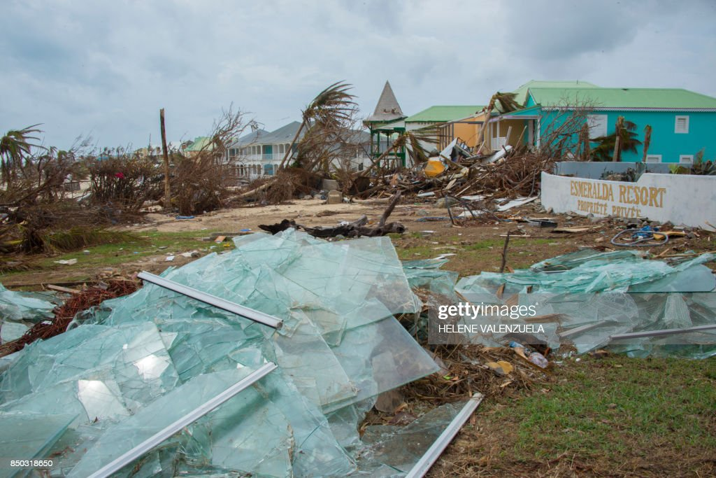Destroyed glass panes are seen after the passage of hurricane Irma and Maria in Orient Bay, St. Martin, on September 20, 2017. After killing at least nine people in the Caribbean, Maria slammed into Puerto Rico's southeast coast at daybreak before churning across the US territory which is home to 3.4 million. / AFP PHOTO / Helene Valenzuela