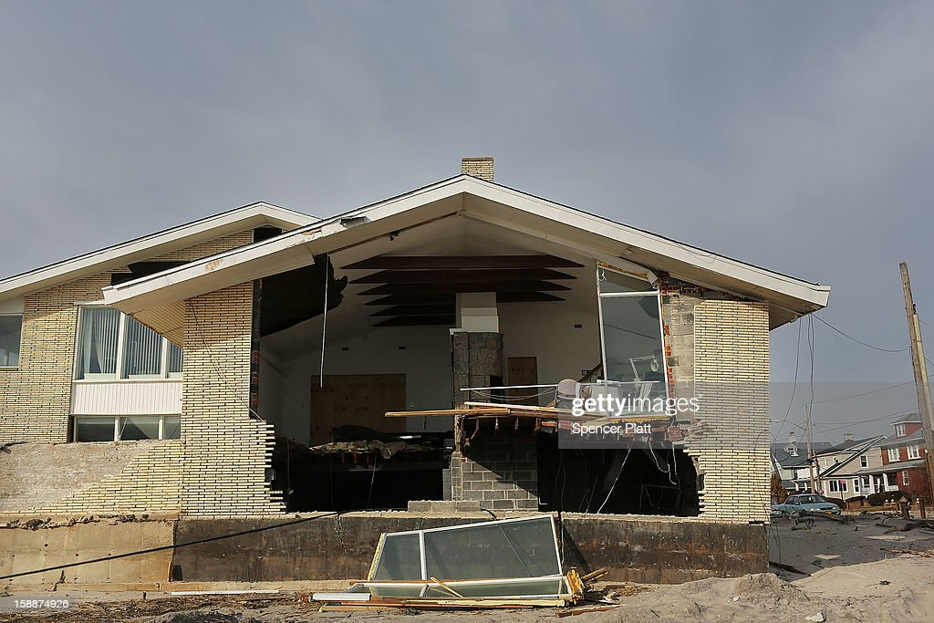A destroyed home is viewed along the beach in the Belle Harbor neighborhood in the Rockaways on January 2, 2013 in the Queens borough of New York City. Criticism, including by President Barack Obama, has been directed at the Republican House's decision to adjourn without passing a Superstorm Sandy aid bill. According to early estimates, Superstorm Sandy inflicted at least $50 to $60 billion in damage across the Northeast, making it one of the most destructive storms ever.