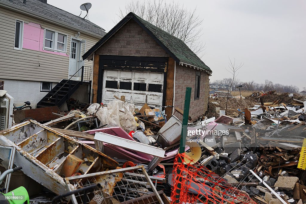 A destroyed home is viewed in Oakwood Beach in Staten Island on February 5, 2013 in New York City. In a program proposed by New York Governor Andrew Cuomo, New York state could spend up to $400 million to buy out home owners whose properties were destroyed by Superstorm Sandy. The $50.5 billion disaster relief package, which was passed by Congress last month, would be used to fund the program. If the program is adopted, homeowners would be relocated and their land would be left as a natural barrier to help absorb future floods waters.