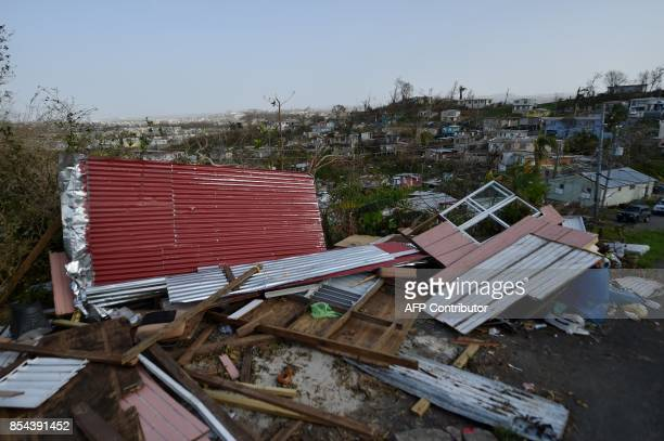 Destroyed homes are seen following passage of Hurricane Maria in the neigborhood of Acerolas in Toa Alto Puerto Rico on September 26 2017 The US...