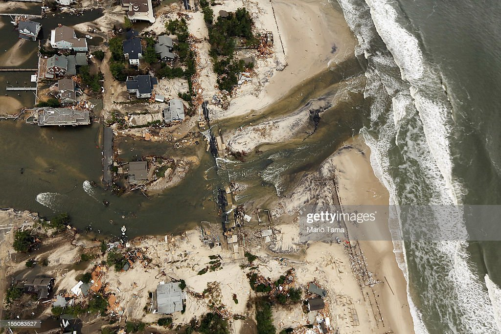 Destroyed homes sit at the edge of the Atlantic Ocean after Superstorm Sandy on October 31, 2012 in Mantoloking, New Jersey. At least 50 people were reportedly killed in the U.S. by Sandy with New Jersey suffering massive damage and power outages.