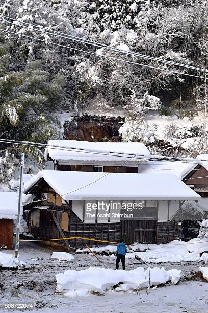 A destroyed house after the snowstorm triggered a landslide killing a 88yearold woman is seen on January 25 2016 in Nichinan Tottori Japan Low...
