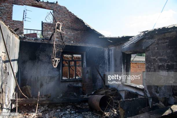 A destroyed house is seen near the warehouse storing ammunition for multiple rocket launcher systems at a military base in Pavlivka Vinnytsia region