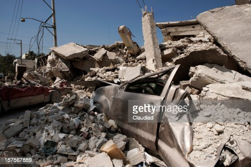 Destroyed houses and cars after earthquake