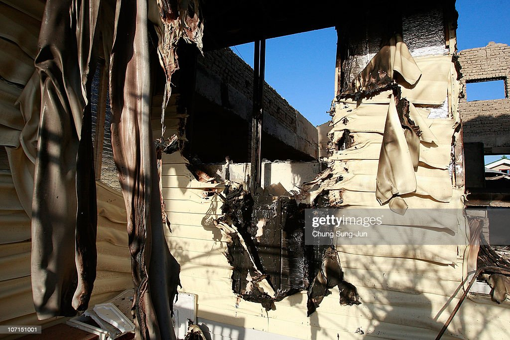 Destroyed houses are pictured following artillery exchange between North and South Korea on November 26 2010 in Yeonpyeong Island South Korea South...