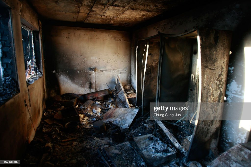 Destroyed houses are pictured following artillery exchanges between North and South Korea on November 25 2010 in Yeonpyeong Island South Korea Dozens...