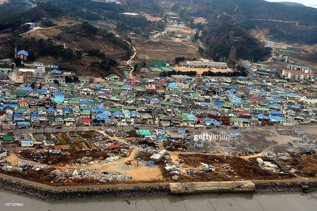 Destroyed houses are seen on Yeonpyeong Island South Korea following artillery exchange between North and South Korea on November 24 2010 in...