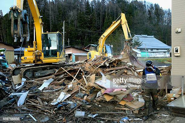 Destroyed houses by the magnitude 67 earthquake a week ago was demolished on November 29 2014 in Hakuba Nagano Japan With the snow season approaching...