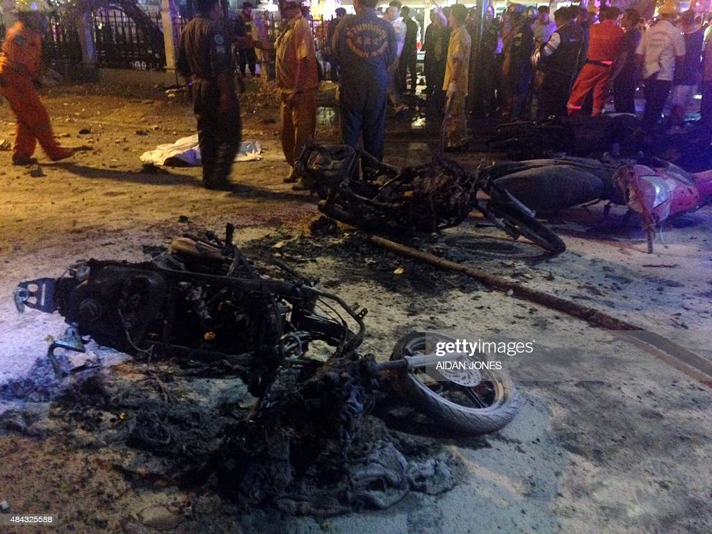Destroyed motorbikes are pictured at the scene of devastation after a bomb exploded outside a religious shrine in central Bangkok late on August 17...
