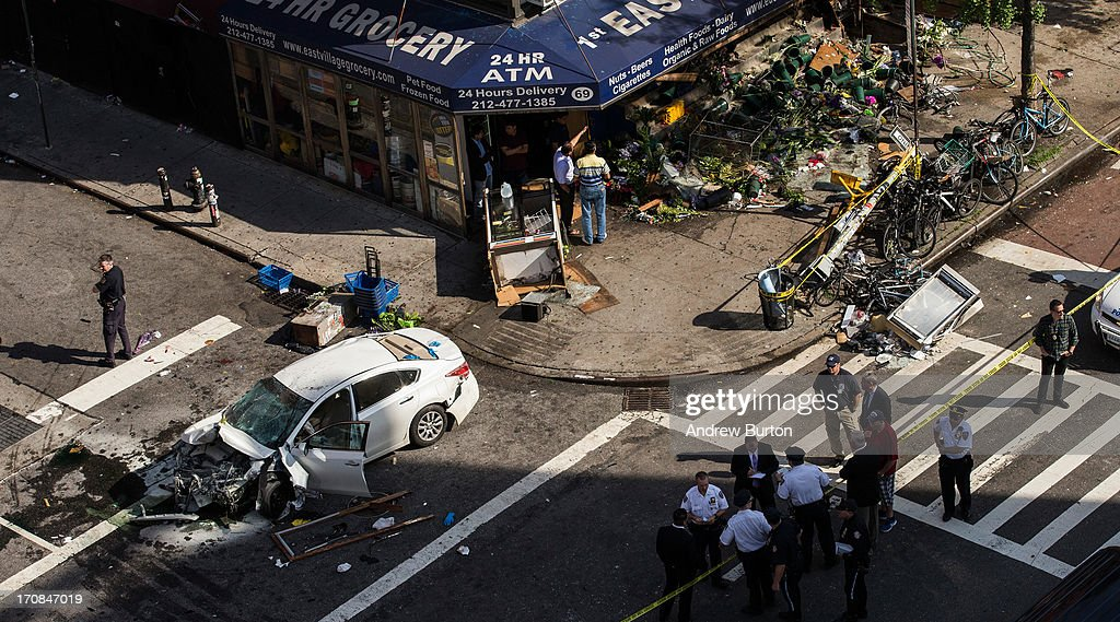 A destroyed Nissan Altima sits in the street after crashing in the East Village neighborhood of New York City on June 19 2013 According to reports at...