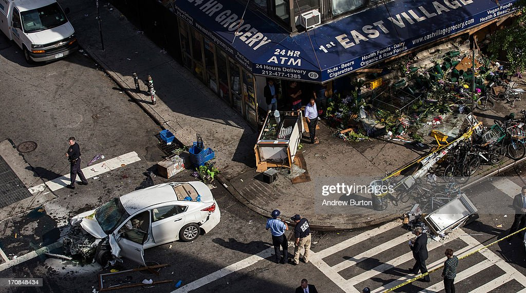 A destroyed Nissan Altima sits in the street after crashing in the East Village neighborhood of New York City on June 19, 2013. According to reports, at least eight people were injured when the car crashed into a storefront on the corner of Second Ave and East Fourth Street.