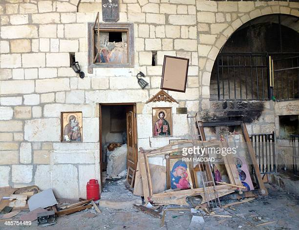 Destroyed religious icons are pictured inside a church in the ancient Christian town of Maalula on April 20 2014 Residents of Maalula returned to the...