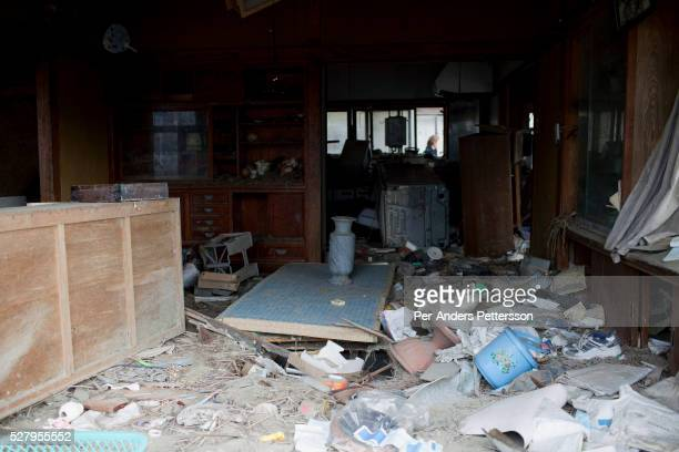 A destroyed residential area still not being cleared eight months after the tsunami on December 2in Higashi Japan The small town was almost wiped off...