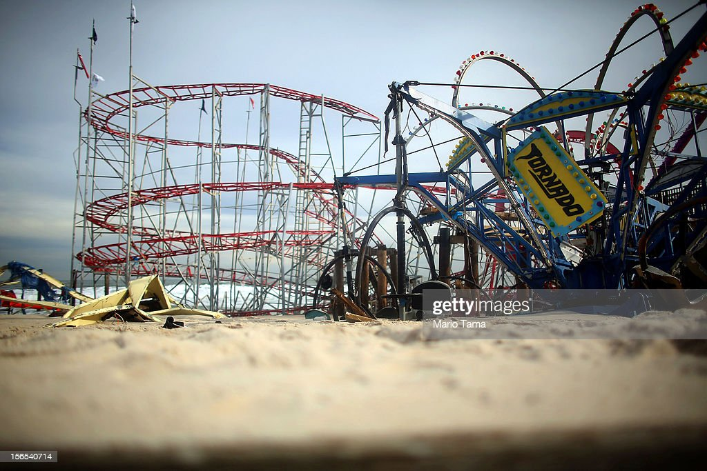 Destroyed rides sit on the beach from the Funtown Pier on November 16, 2012 in Seaside Heights, New Jersey. Two amusement piers and a number of roller coasters were destroyed in the seaside town by Superstorm Sandy.