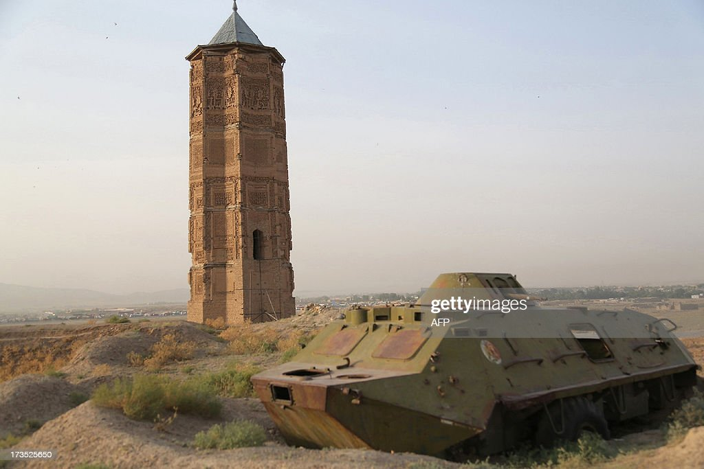 A destroyed Russian tank is seen alongside one of two minarets built in the 12th century in Ghazni city on July 16, 2013. Ghazni has been chosen by the United Nations Educational, Scientific and Cultural Organisation (UNESCO) as the City of Islamic Culture for the Asian region for 2013. The city, south of Kabul, boasts a number of important pre-Islamic and Islamic sites but due to the security situation cannot be reached by foreign tourists. AFP PHOTO / Rahmatullah ALIZADA