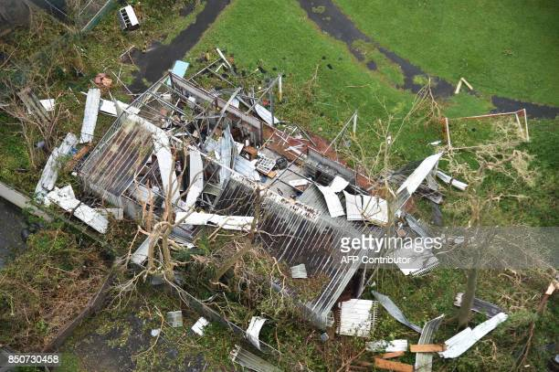 TOPSHOT A destroyed shack is seen in the Rio Piedras area in San Juan Puerto Rico on September 21 2017 Puerto Rico braced for potentially calamitous...