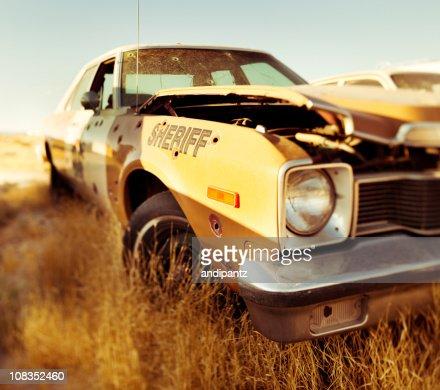destroyed Sheriff's car : Stock Photo