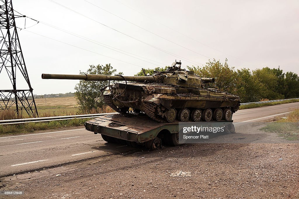 A destroyed tank is viewed on the road out of Donetsk on September 12 2014 in Donetsk Ukraine Ilovaisk which is about an hour outside of the...