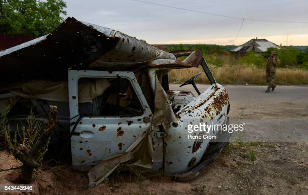 A destroyed van is seen on the frontline on September 06 2017 in Avdiivka Ukraine The frontlinecity Avdiivka is located on the outskirsts of Donetsk...