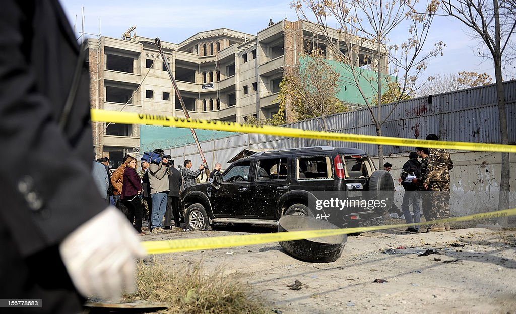 A destroyed vehicle is pictured at the scene of a suicide attack in Wazir Akbar Khan district of Kabul on November 21, 2012. A suicide bomber blew himself up near a NATO base in Kabul's diplomatic district on Wednesday, hitting a military vehicle and killing two people, police and a military spokesman said. AFP PHOTO/Jawad Jalali