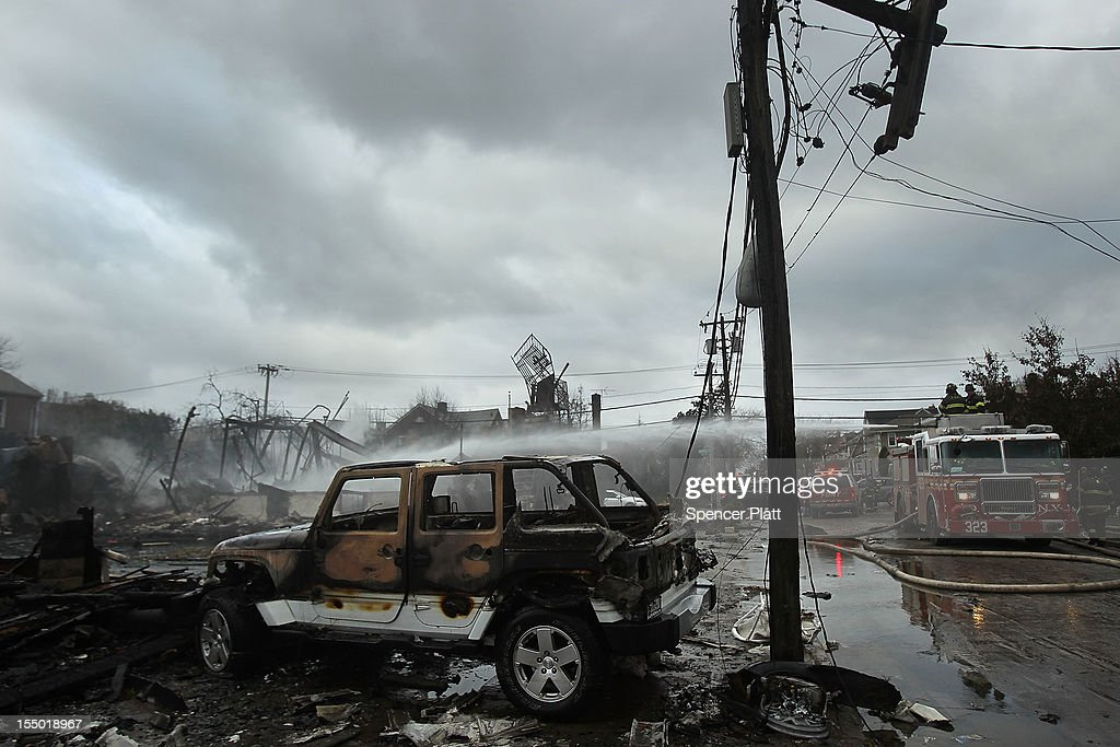 A destroyed vehicle sits near burnt homes and businesses after Hurricane Sandy on October 30, 2012 in the Rockaway section of the Queens borough of New York City. At least 40 people were reportedly killed in the U.S. by Sandy as millions of people in the eastern United States have awoken to widespread power outages, flooded homes and downed trees. New York City was hit especially hard with wide spread power outages and significant flooding in parts of the city.
