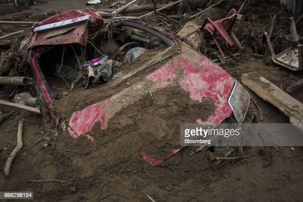 A destroyed vehicle sits under debris after a landslide in Mocoa Putumayo Colombia on Monday April 3 2017 Torrential rains caused water mud and...