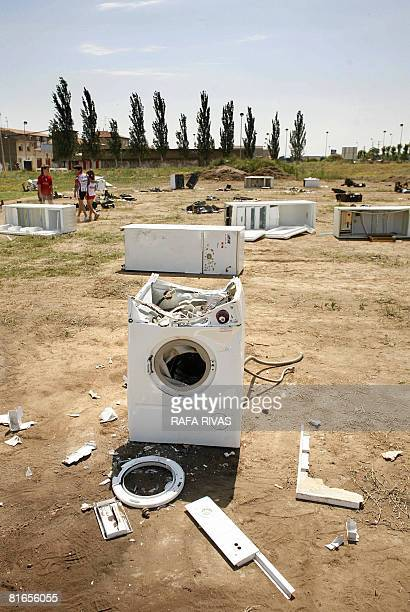 A destroyed washing machine and other appliances remain on the ground after a 'destructtherapy' session organized by StopStress group on June 21 2008...