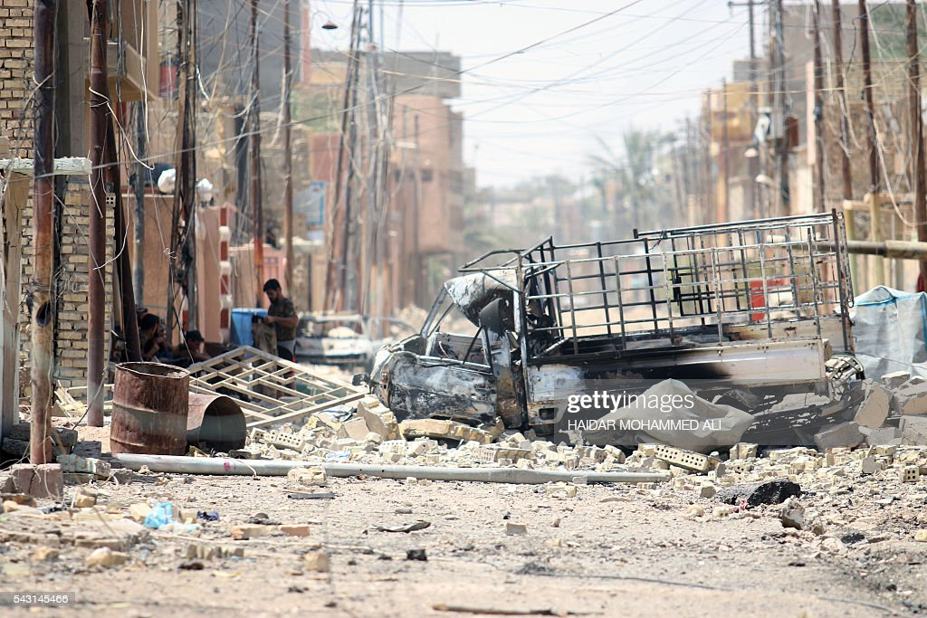 Destruction is seen in Fallujah, 50 kilometres (30 miles) from the Iraqi capital Baghdad, after Iraqi forces retook the embattled city from the Islamic State group on June 26, 2016. Iraqi Prime Minister Haider al-Abadi urged all Iraqis to celebrate the recapture of Fallujah by the security forces and vowed the national flag would be raised in Mosul soon. While the battle has been won, Iraq still faces a major humanitarian crisis in its aftermath, with tens of thousands of people who fled the fighting desperately in need of assistance in the searing summer heat. ALI