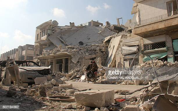 Destruction is seen in Idlib in northwestern Syria on December 21 2015 following reported Russian air strikes Suspected Russian air strikes killed 36...