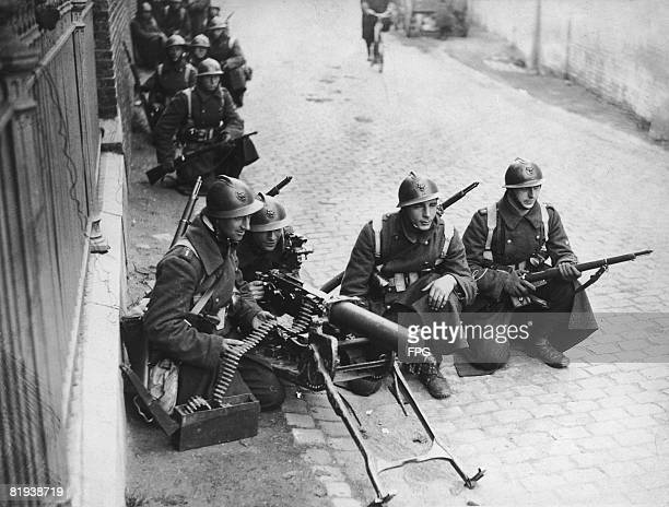 A detachment of Belgian machine gunners carry out training manoeuvres in Herve 7th October 1936