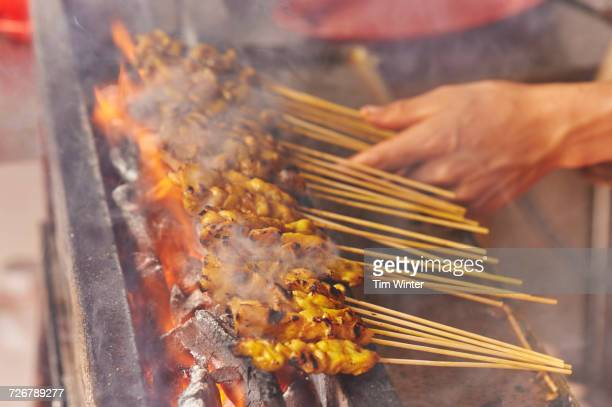 Detail, chicken satay cooked at street market, Chinatown, Malacca, Malaysia, Southeast Asia, Asia