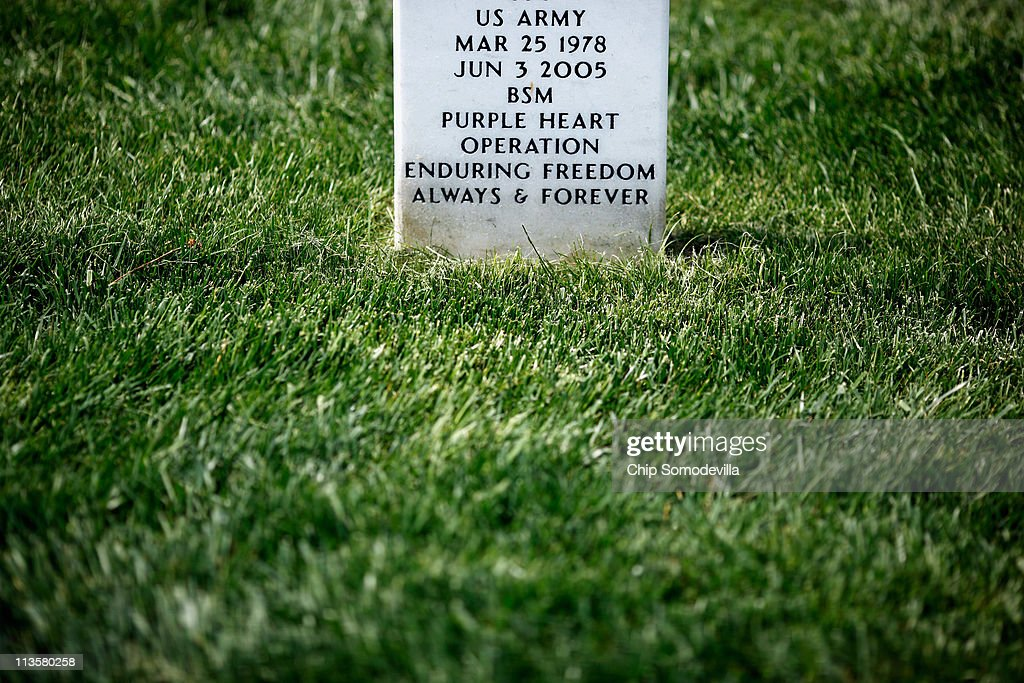 A detail from the grave marker of a solider killed during Operation Enduring Freedom in Arlington National Cemetery's Section 60, where troops killed in the wars in Iraq and Afghanistan are buried, May 3, 2011 in Arlington, Virginia. About 1,500 American troops have died in the war in Afghanistan, sparked by the September 11, 2001 attacks on the United States which were masterminded by the Saudi-born terrorist Osama Bin Laden. News of Bin Laden's death Sunday during a U.S. Special Forces raid of his compound in Pakistan lead to mixed reactions around the world.