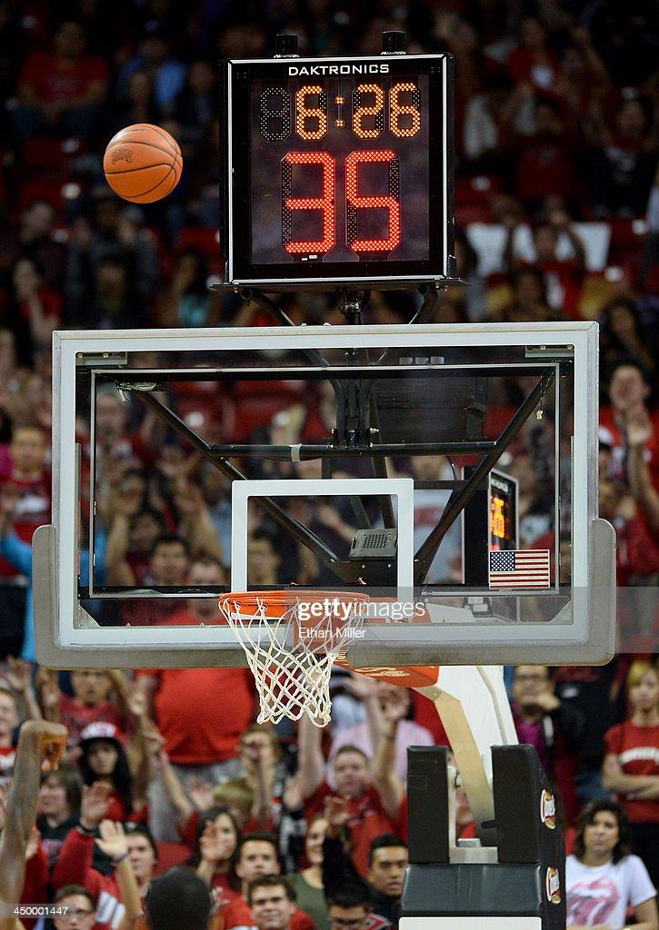 A detail image of a backboard, shot clock, game clock and a basketball during a game between the Nebraska-Omaha Mavericks and the UNLV Rebels at the Thomas & Mack Center on November 15, 2013 in Las Vegas, Nevada.