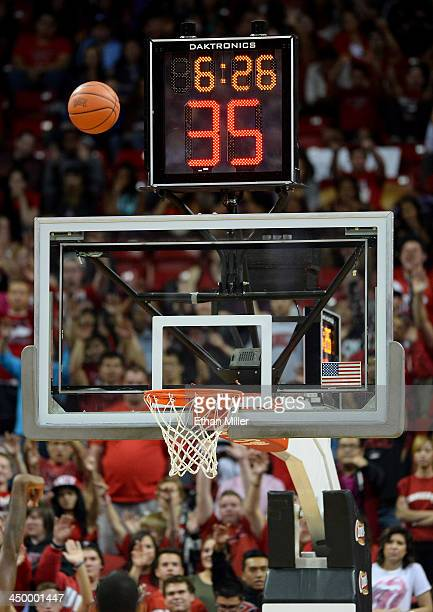 A detail image of a backboard shot clock game clock and a basketball during a game between the NebraskaOmaha Mavericks and the UNLV Rebels at the...
